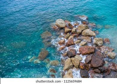 Crystal clear Italian seaside town Monterosso beautiful romantic seaside reef background