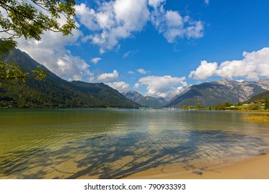 Crystal clear lake water of Achensee lake in blue green shade of fresh Turquoise water, northern part of Achen Lake during Autumn in Tyrol, Austria, Europe