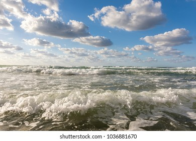 crystal clear sea and frothy waves on the beaches of Palermo in Sicily in Italy
