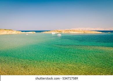 The crystal clear sea surrounding the island of Rab, Croatian tourist resort.