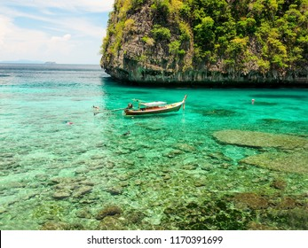 crystal clear sea water with blue sky at Phi Phi island, Phuket, Thailand