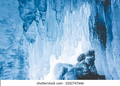 Crystal clear sharp icicles hanging down in frozen cave, lake Baikal, Olkhon island,