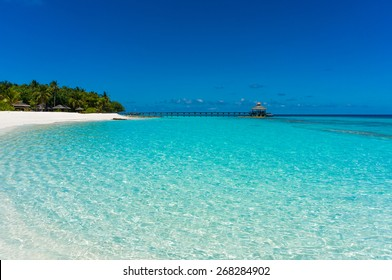 Crystal clear turquoise water and white sandy beach, Baa Atoll, Maldives