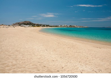 Crystal clear turquoise waters of the  Mikri Vigla sandy beach at Naxos island in Greece