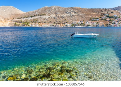crystal clear water in aegean sea on Symi island in Greece