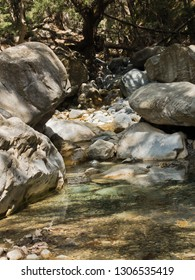 Crystal clear water of a cold mountain creek at rocky terrain of Samaria gorge, south west part of Crete island, Greece