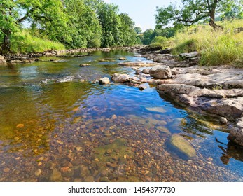 Crystal clear water of the River Ribble flows gently through the Yorkshire Dales near the village of Stainforth