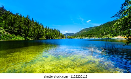 The crystal clear waters of Allison Lake along Highway 5A between the towns of Merritt and Princeton in British Columbia, Canada