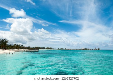 The crystal clear waters and the blue sky over the beach in Nassau, the capital of The Bahamas.
