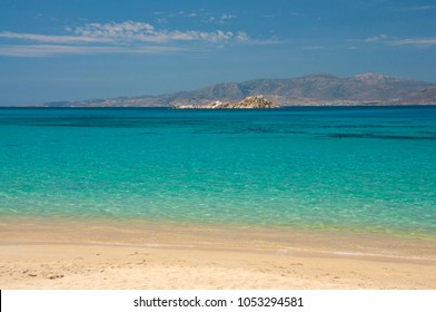 Crystal clear waters of Mikri Vigla beach at Naxos island in Greece