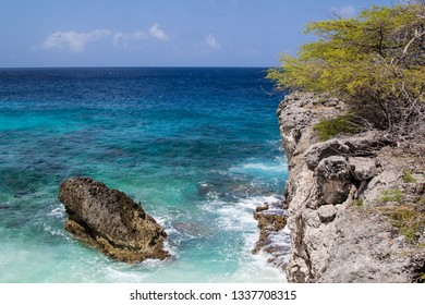 Crystal clear waters, smooth surf  and a rocky coast on ther north shore of the tropical island of Bonaire in the Washington Slagbaai national park