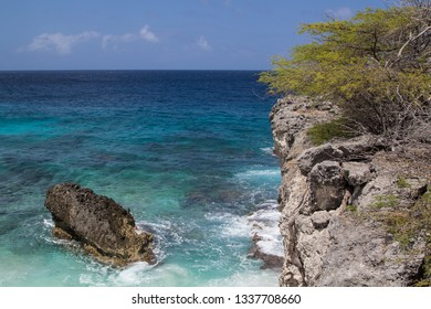 Crystal clear waters, smooth surf and a rocky coast on the north shore of the tropical island of Bonaire in the Netherlands Antilles