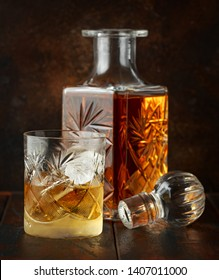 Crystal decanter and glass with whiskey and ice