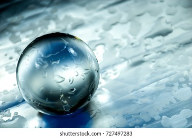 Crystal or glass ball in an abstract lightning