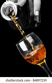 crystal glass filled with brandy isolated on a black background