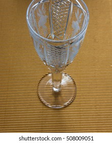Crystal glass on a gold background.