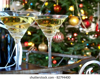Crystal glasses with wine bottle on the Christmas tree background