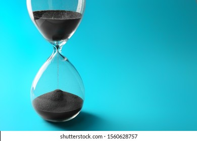 Crystal hourglass on color background