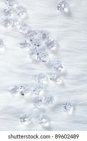 crystal ice cubes on winter white fur background