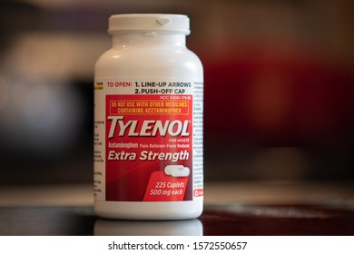 Crystal Lake, Illinois/USA 11.27.2019 Bottle of Adult Tylenol Extra Strength with a blurry background