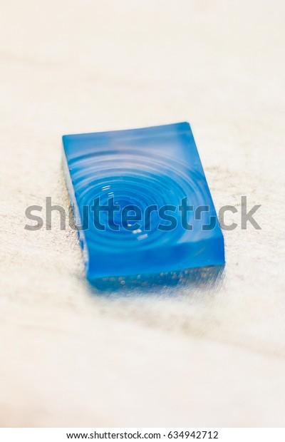 crystal made of epoxy resin close-up with bokeh on background shallow depth of field