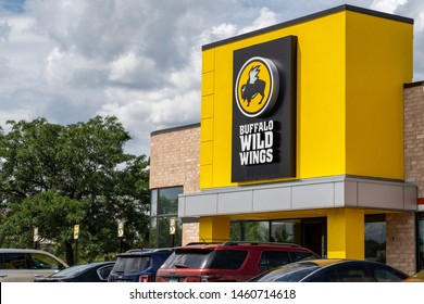 Crystal, Minnesota - July 21, 2019: Exterior of a Buffalo Wild Wings chain restaurant. Also known as B-Dubs, this dine-in establishment sells chicken wings and pub food