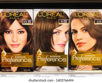 Crystal, Minnesota - May 17, 2019: Loreal Preference hair dye kits on sale at a Target store shelf. Shown in shades of brown/brunette