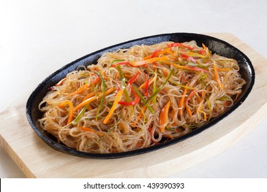crystal noodles with vegetables in a pan isolated cast iron wok