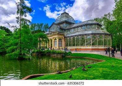 Crystal Palace (Palacio de cristal) in Retiro Park in Madrid, Spain. Retiro Park is one of the largest parks of the city of Madrid, Spain. Architecture and landmark of Madrid