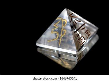 Crystal in Pyramid Shape With REIKI symbols : Cho Ku Rei  means Power, Sei Hei ki means Harmony, Hon sha ze sho nen means  Distance, Dai ko myo means Master, Raku =completion