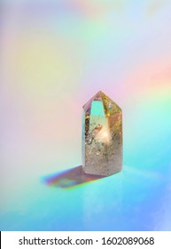 Crystal quartz Refracting light in rainbow colors. magic stone quartz on holographic background. optical experiments. spiritual healing crystal practice. Feng Shui, Good energy flow concept