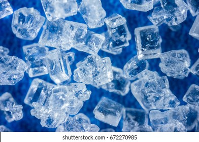 The Crystal shape flakes on blue background, Magnification macro zoom of Salt, shallow DOF