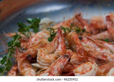 crystal shrimps with the head still on , cooking in a pan