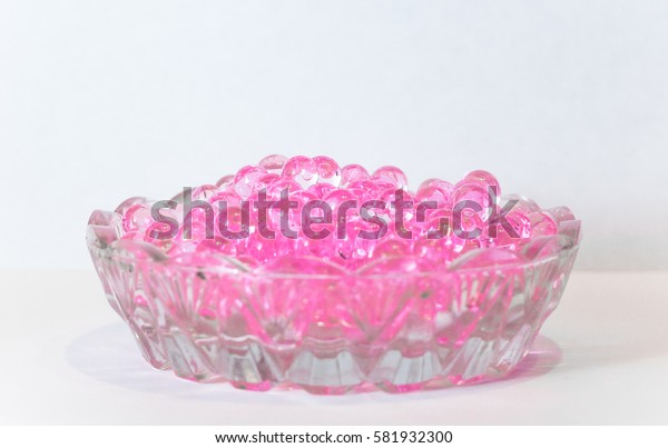 Crystal silicone flavored balls in a glass small saucer