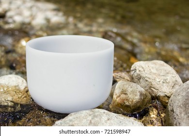 Crystal Singing Bowl into the river. Meditation and relax.