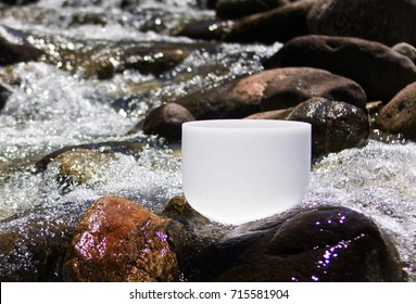 Crystal Singing Bowls for healing and meditation into the river water.