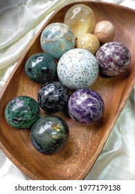 Crystal spheres in a wooden bowl