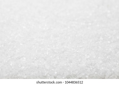 crystal sugar or salt background, white grain texture