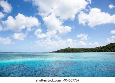 Crystal turquoise blue sea in a tropical beach on sunny day. Transparent sea water. Sunny day sea background.