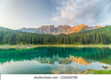 crystal water of Lake Carezza (Karersee) in Dolomite Alps, Trentino Alto Adige, South Tirol, Italy at daytime