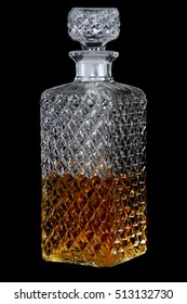 Crystal whisky decanter isolated on a black background