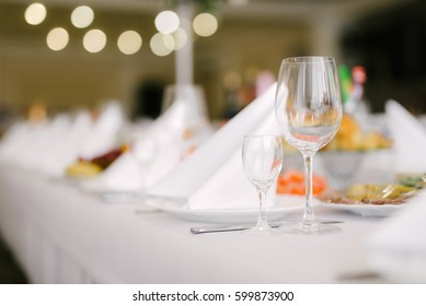 Crystal wine glasses on the festive table, wedding servings