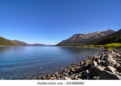crystal-clear water of Brazo Huemul of lake Nahuel Huapi with view towards the andes between Bariloche and Villa La Angostura, Argentina, Patagonia