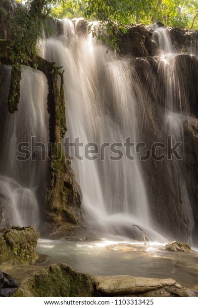 Crystalline waterfall with rocks in a park