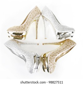 crystals encrusted shoes on white background