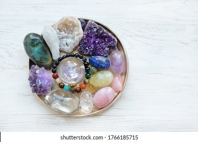 Crystals gemstones Set on white wooden table. healing minerals for esoteric spiritual practice, relaxation, meditation, reiki therapy. Crystal ritual for modern magic, witchcraft. flat lay