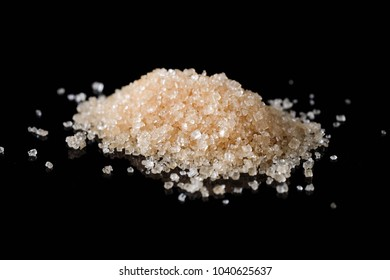 Crystals Sugar,Brown cane sugar isolated on black background