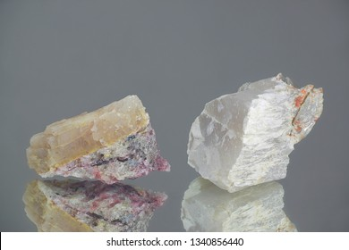 Crystals of two major industrial lithium ores.  Left spodumene, right petalite.  Sample from Haapaluoma lithium quarry in Finland.