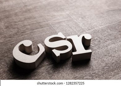 CSR abbreviation wood letters (Corporate Social Responsibility) on the table with copy space
