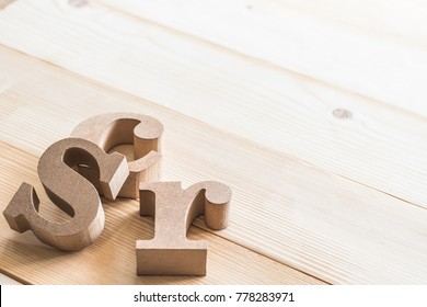 CSR (Corporate social responsibility) abbreviation wood letters on natural white wooden background for business vision concept backdrop
